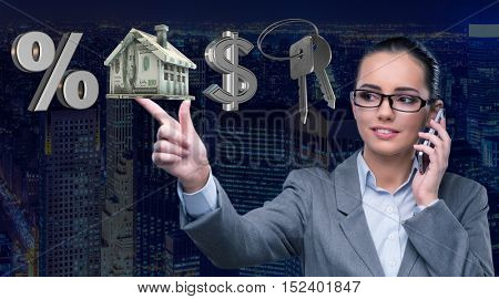 Businesswoman talking on mobile phone in mortgage concept