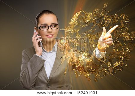 Businesswoman with dollars talking on mobile phone