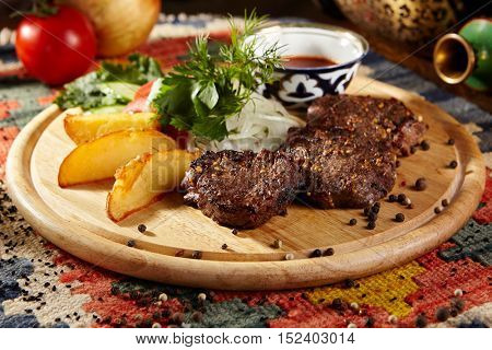 Grilled Beef Steaks with Onions and Vegetable