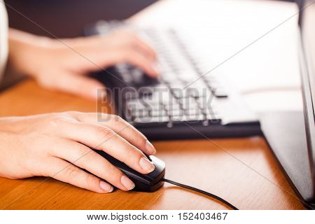Close-Up of Woman hands Using Mouse and Keyboard