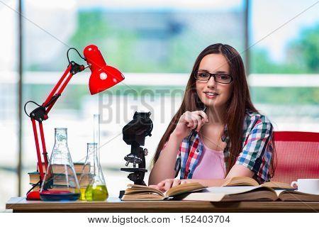 Female student preparing for chemistry exams
