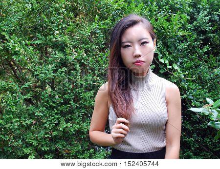 Asian female beauty fashion model expressions outside.
