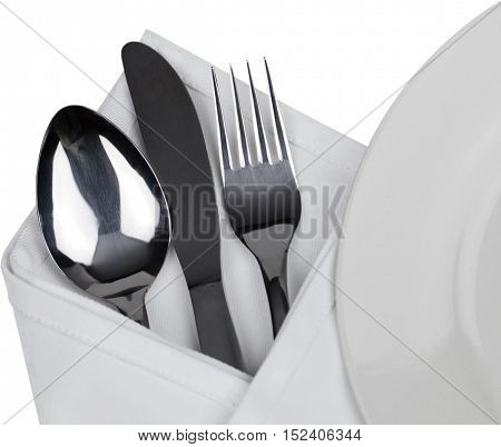 Flatware and a napkin next to a plate