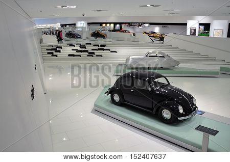 STUTTGART, GERMANY - APRIL 21, 2015. The white interior of the Porsche cars museum. Black retro car. Stuttgart, Germany.