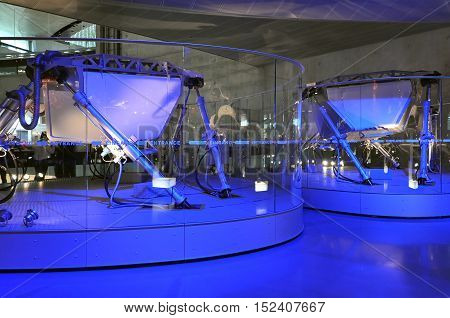 Stuttgart, Germany - April 22, 2014: Interior of a modern museum of Mercedes cars. The exposition of fantastic robots in blue light.