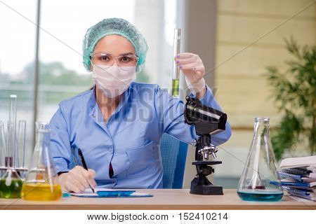 Woman chemist working in the lab