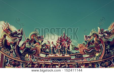 Zhongli District, Taoyuan City - October 2016: Traditional colorful decoration on the roof of chinese temple with dragons and figures.