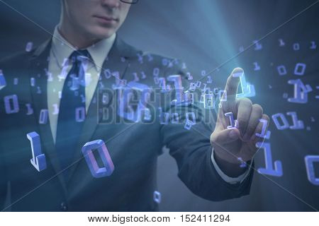Businessman pressing binary buttons in tech concept