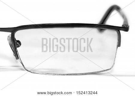 The left side of glasses on white background