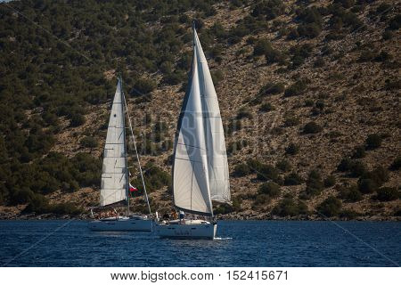 ERMIONI, GREECE - OCT 5, 2016: Sailors participate in sailing regatta 16th Ellada Autumn 2016 among Greek island group in the Aegean Sea, in Cyclades and Saronic Gulf.