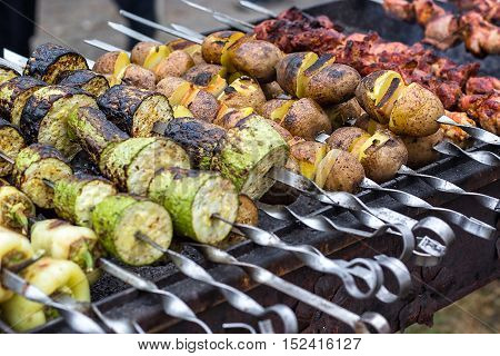 Skewered vegetables green zucchini courgettes cucumber peppers preparing barbecue grill charcoal Grilled roasted fried slices covered beautiful crust Mediterranean cuisine delicious food bbq party