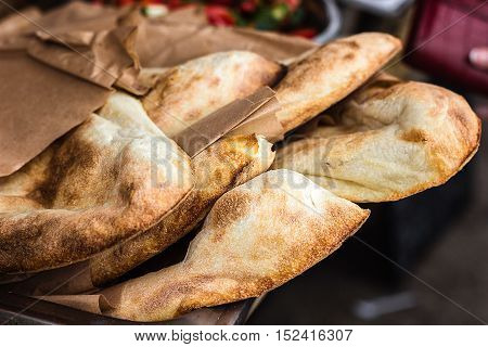 Lavash, Bakery Products fresh pastry sells pita market wheat tortillas close-up Caucasian kitchen Lavash Pita or Arabic bread traditional healthy eastern Georgian flatbreads paper bags country Georgia