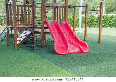 Slider (Kids playground )at the park with artificial grass