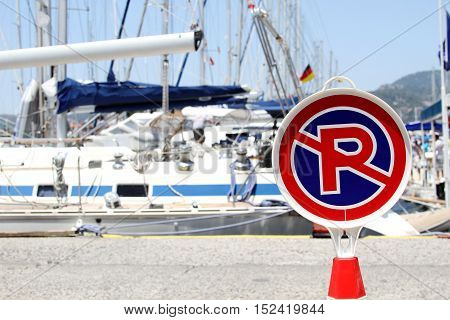 Many boats moored in the harbor. No sign parking