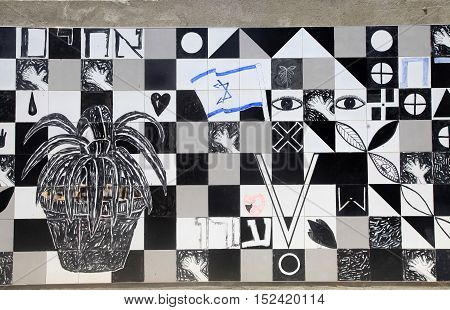 TEL AVIV, ISRAEL - AUGIST 24, 2016: part of the black and white contemporary tile mosaic decoration on street wall in Tel-Aviv, Israel