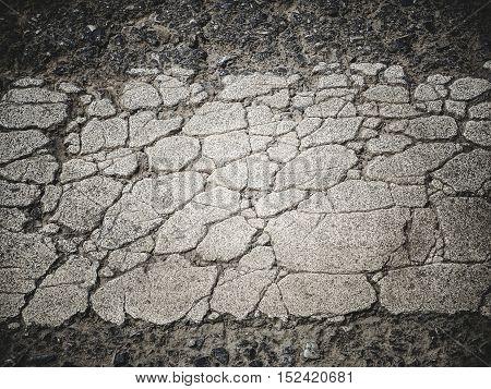 Cracked asphalt road surface background/ Color filter effect