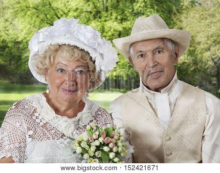 Portrait of an elderly couple in summer hats