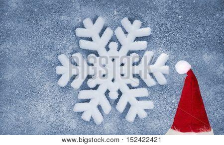 Snowflake, grey fiber fabric and blue glitter film, background