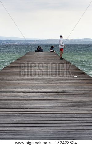Sirmione, Italy - July 31: People On Wooden Pier On Lago Di Garda On 31 July 2016 In Sirmione, Italy