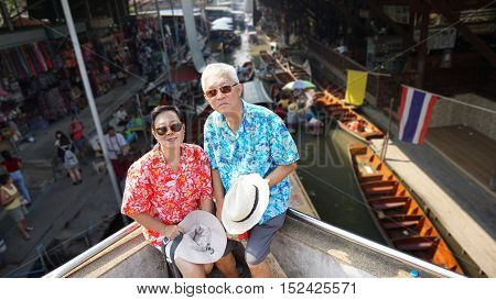 Asian Elderly Couple Having Retirment Trip To Thailand Floating Market