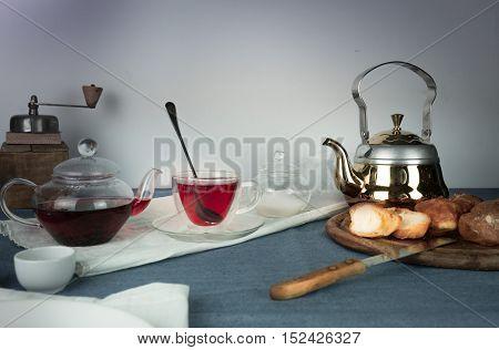 still life. hibiscus tea, buns on a blue tablecloth
