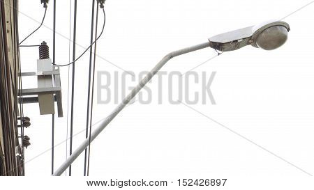 Street light and power lines high voltage lamp cover is old acrylic and damaged at Nonthaburi provice Thailand.