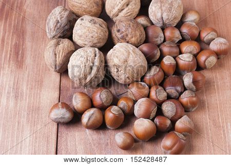 Mix of nuts on wooden background. Healthy eating