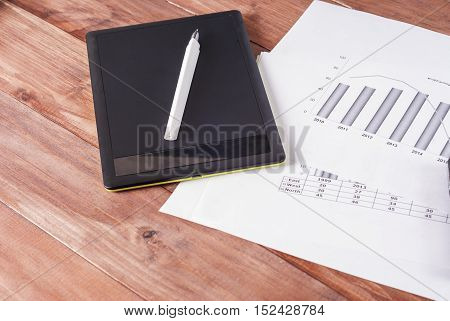 Black book for records and hand on the financial statements