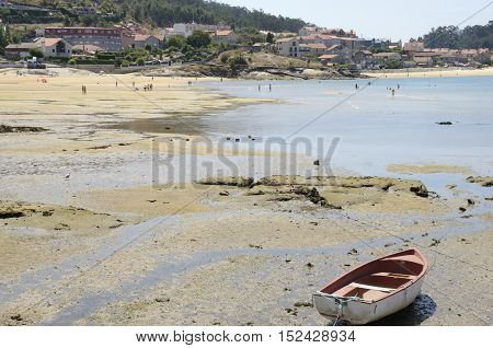 ALDAN, SPAIN - AUGUST 9, 2016: People having a bath in the beach of the village of Aldan Galicia Spain