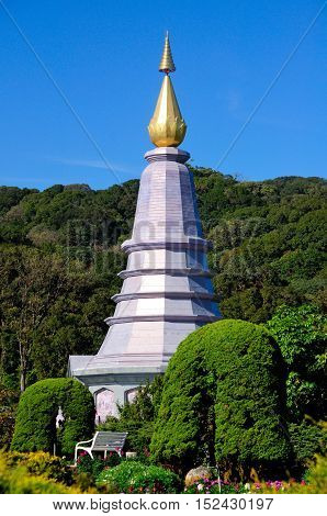 The top of the Queen's Pagoda against at blue sky in Doi Inthanon National Park Thailand on a sunny day.