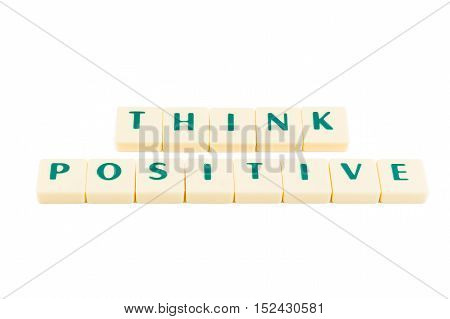 Letters forming the words THINK POSITIVE on a white background