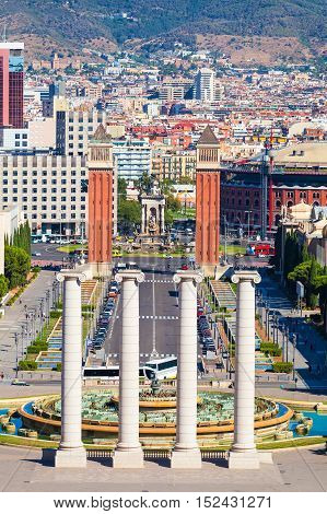 Square of Spain in Barcelona with two Venetian towers in red brick and columns in the foreground, Plaza de Espana. Spain.