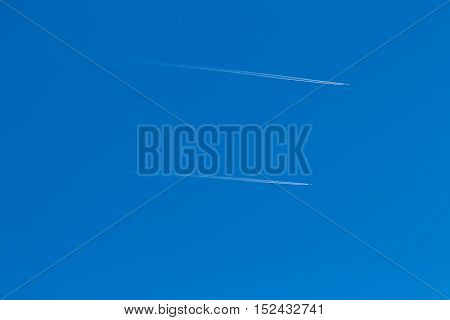 Two Small Aircraft Flying Parallel To The Sky Without Clouds And Reverse Trace Of Them