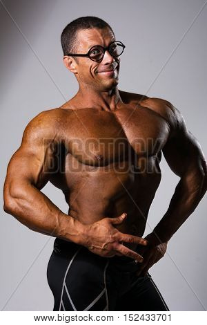 Happy Muscular Man With A Naked Torso And Funny Glasses