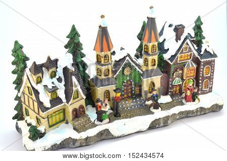 Village of Christmas in plaster under the snow.