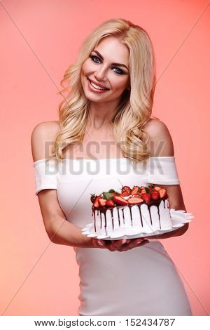 Beautiful Young Woman Holding Self-made Cake Isolated