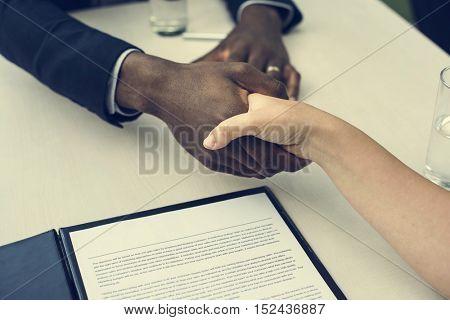 Business Contract Documents Handshake Concept