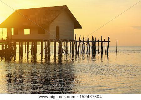 wooden house on sea warm sunset sky