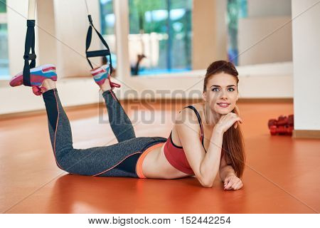 Women with trx fitness straps in the gym Concept workout healthy lifestyle sport.