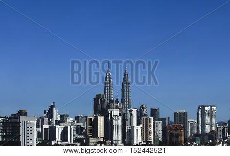 Kuala Lumpur Malaysia city skyline with blue sky