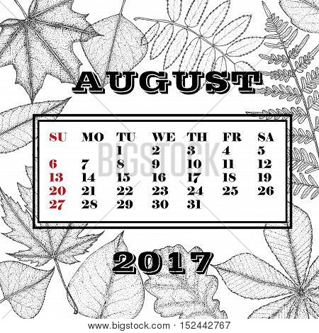 Calendar for the month August 2017 on a background of leaves of trees