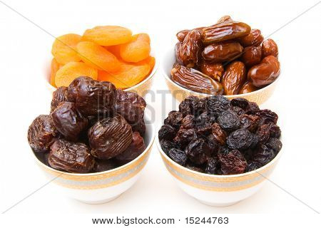 dried fruits in caup isolated on white