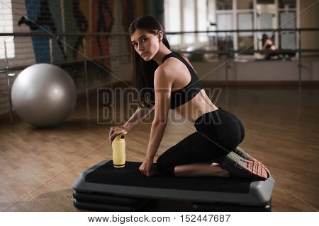 Fitness Trainer Shows The Technique Exercises In Gym, Yoga And Pilates Concept