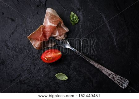 Thin Slices Of Prosciutto With Mixed With Basil, Cherry Tomatoes On Wooden Cutting Board,vintage Bac