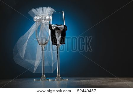 Two wineglass with special decoration for wedding party isolated