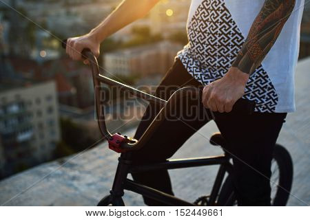 People, Travel, Tourism, Leisure And Lifestyle - Close Up Of Young Hipster Man Hands Holding Fixed G