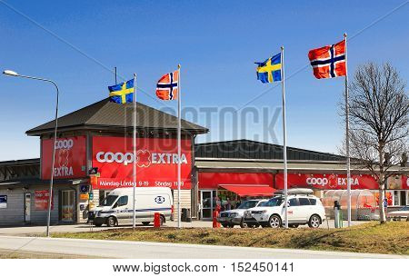 Storlien, Sweden - May 27, 2014: Norwegian and Swedish flags are hoisted outside the Coop Extra store.