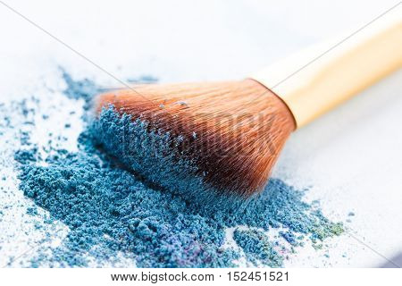Brush lie scattered on blue shadows at white background