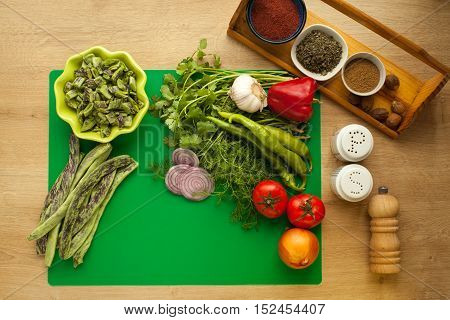 Fresh vegetables prepared for cooking, vegan meal, green beans. Menu for healthy lifestyle, ingredients for cooking salad with spices in kitchen.