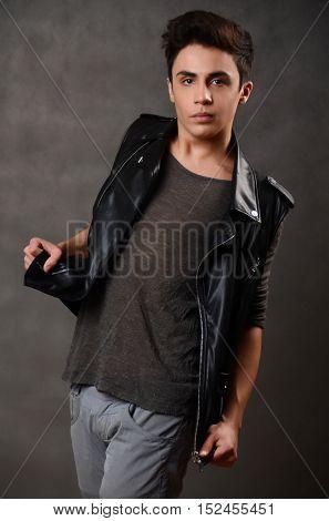 Elegant young man. Studio fashion portrait.